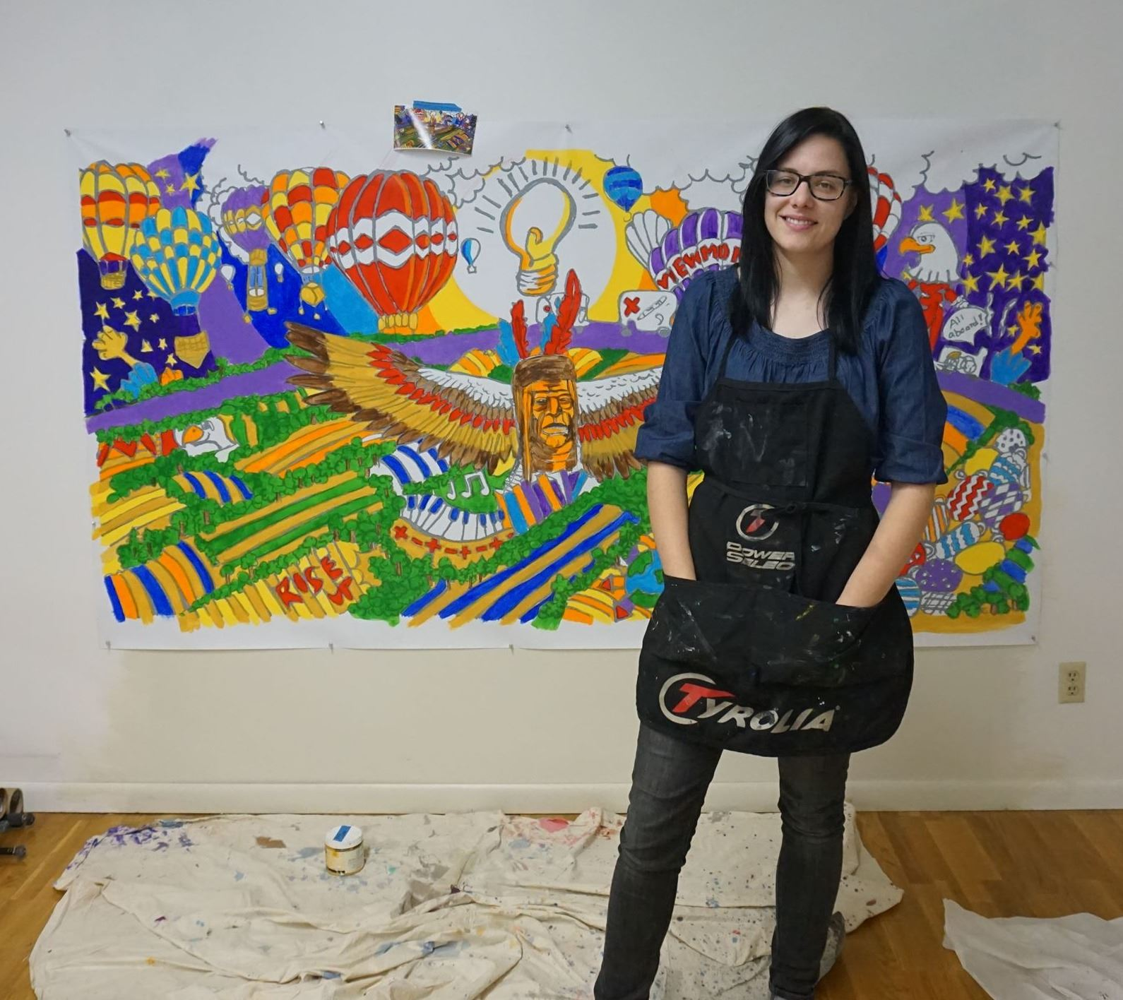 Britt Black in front of mural, 2018